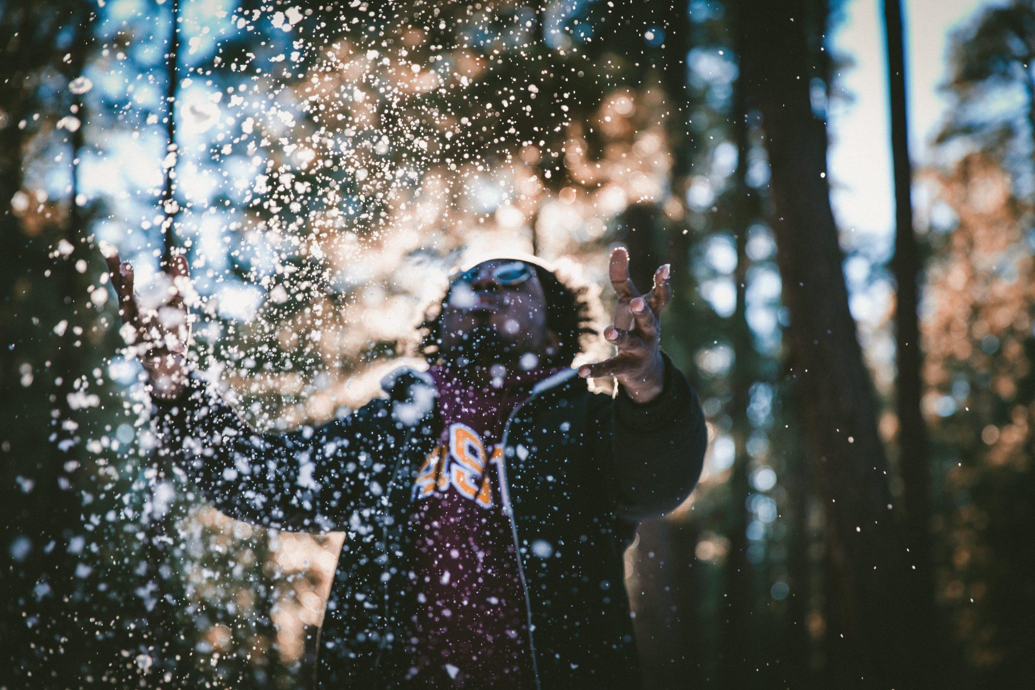 Man trowing snow