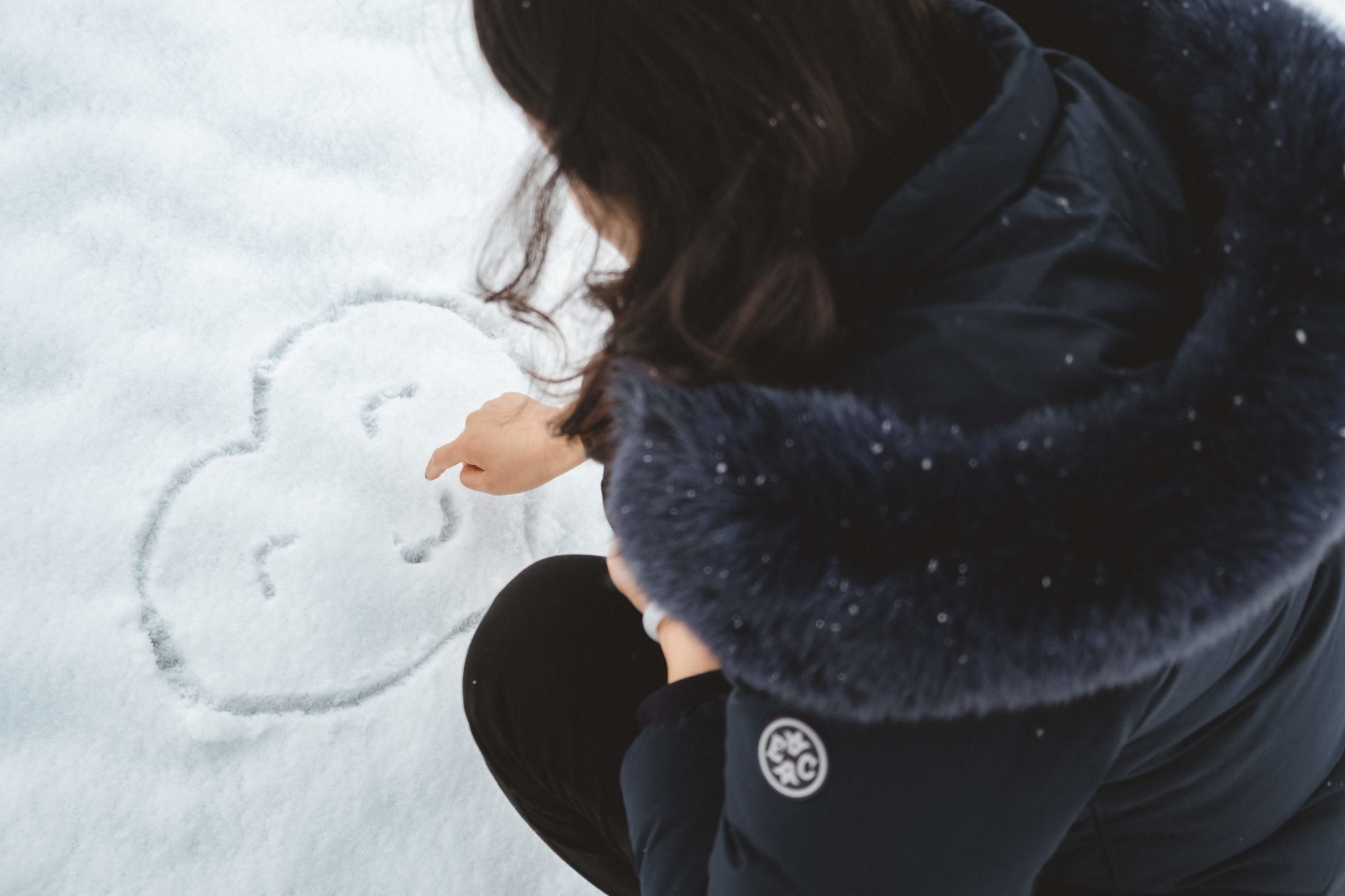 woman writing in the snow